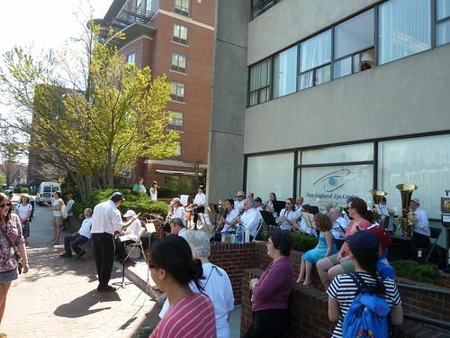 Band on the sidewalk in Brookline on Marathon Monday