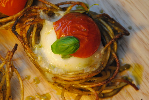 Crispy spaghetti pesto nests, with goats cheese and tomato