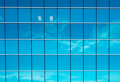 An azure window grid, reflecting clouds. Perfect fit isn't it?