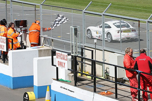 The chequered flag in the Ginetta Racing at the 2012 BTCC weekend at Donington Park in April 2012