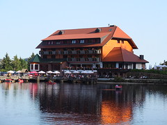 "the mountain hotel on ""Mummelsee"" on a summer day"