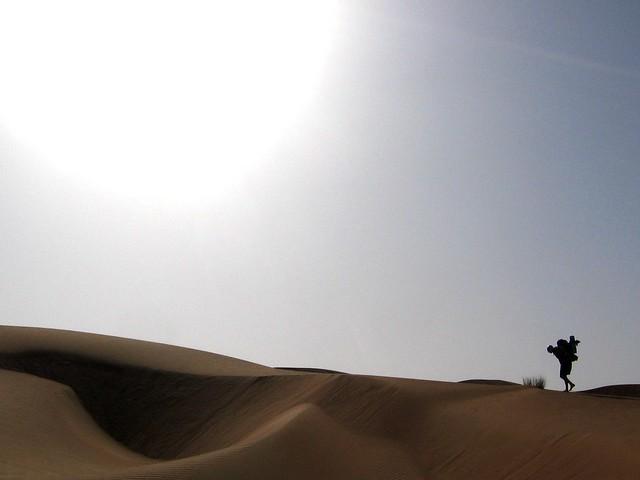 Sherpa-ing a heavy pack along a dune ridge