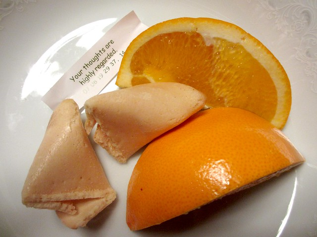 Fortune cookie with orange slices.