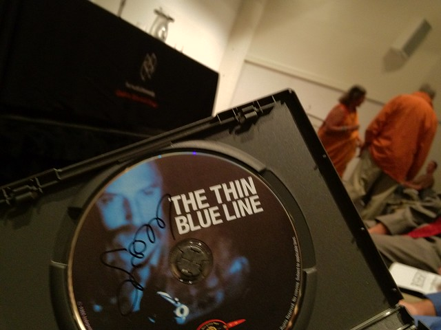 Errol Morris just signed my copy of THE THIN BLUE LINE (Morris in background). COULD THIS DAY GET ANY BETTER?