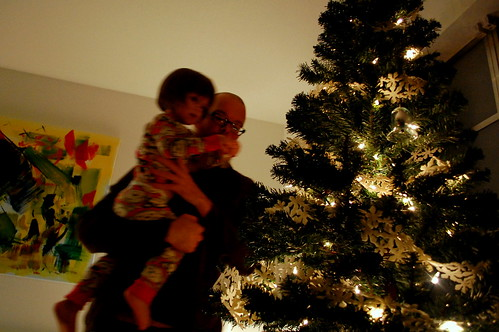 Putting up ornaments with Daddy.