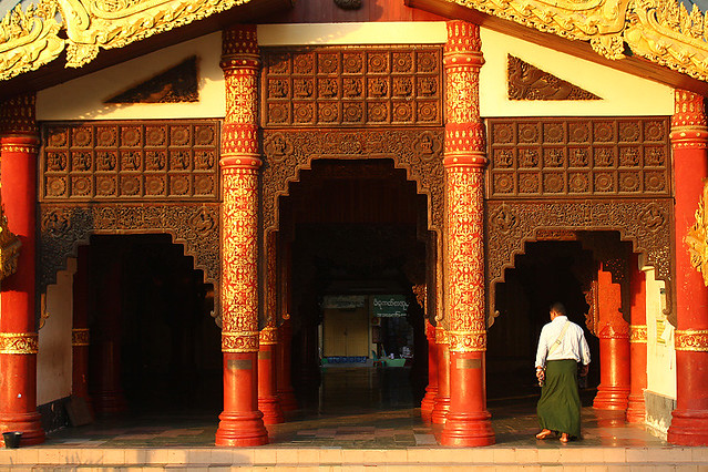 A man walking into a side entrance of the South Gate - Swedagon Pagoda