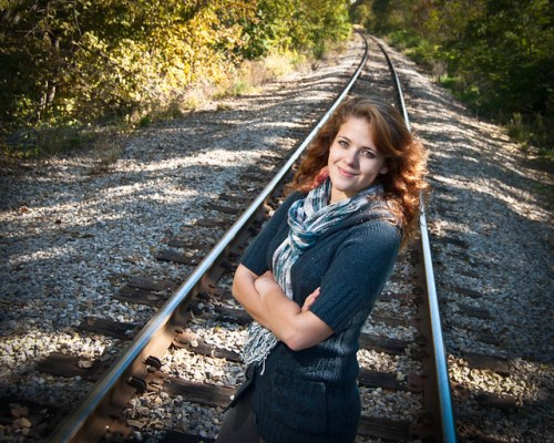 Cassie Standing on Railroad Tracks