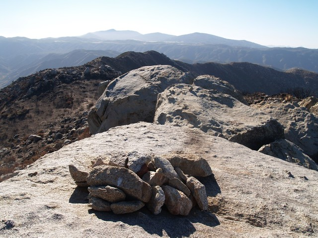 Looking west from the summit block. Stonewall Peak, Cuyamaca Peak, Middle Peak, and North Peak are on the horizon.