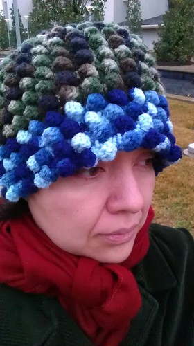 wearing crochet green and blue hat