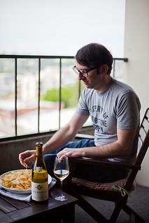 Jameson Fink enjoying crisps (potato chips) and white Burgundy