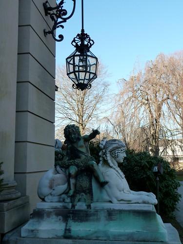 Statue flanking front door