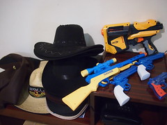 Cowboy hats and toy guns for youth camp