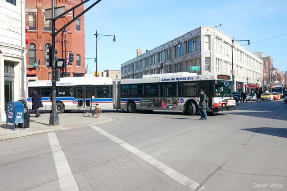 Turning at busy intersections costs buses time.