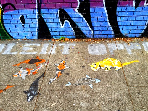 Cat added to Mission sidewalk graffiti