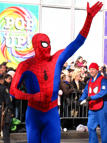 Spiderman waves at the fans