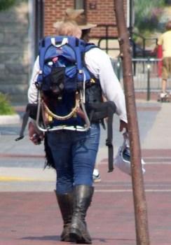 Man with child and boots walking east on Kirkwood.
