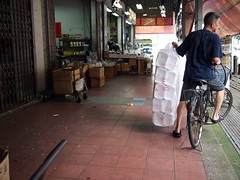 Man on bicycle, Victoria Street Wholesale Centre