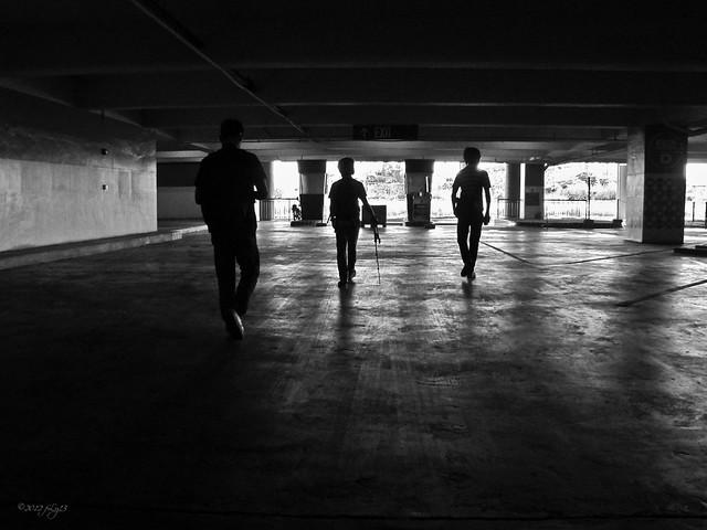 Silhouettes inside a car park
