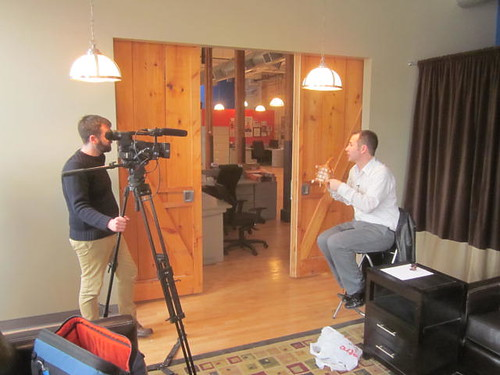 Rob Campbell getting interviewed for TV show
