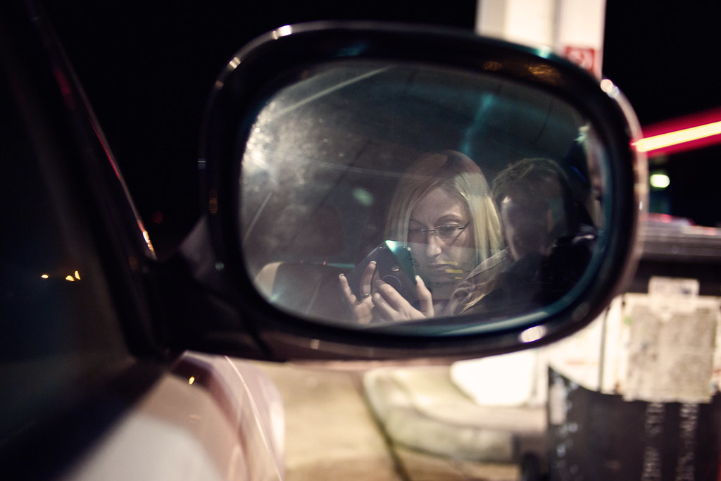 an apple in the rearview mirror
