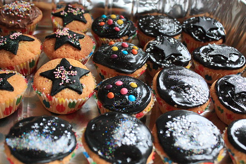 Cakes with black icing and sprinkles. Copyright Janet E Davis 2012.