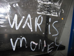 War is Money (Encourage people to consider how our socio-economic-cultural system incentivizes and rewards aggressions and other harmful behaviors/activities.)