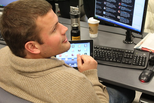 Jacob Kuehn familiarizes himself with the iPad.