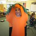 A student dressed in a carrot costume.