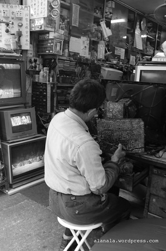 TV technician repairing an old TV.