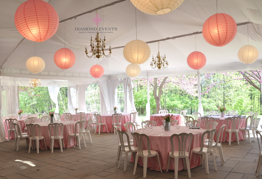 Tent decorate with paper lanterns for wedding reception at Woodend Sanctuary in Chevy Chase, Maryland