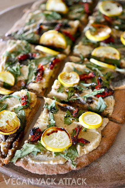 """This Rustic Arugula Flatbread makes for a great, savory entree, or a """"fancy"""" appetizer to share with friends. The cashew spread is exquisite!"""
