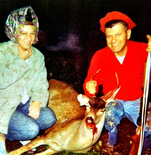 Hunter couple and deer