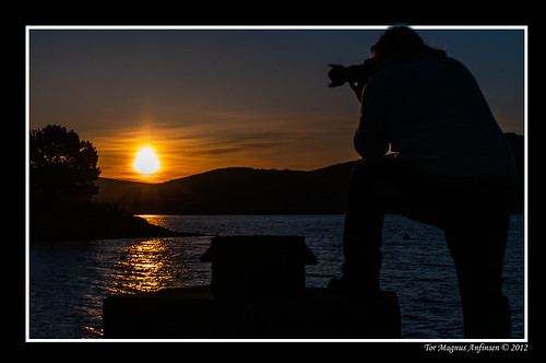 Photographer in sunrise by Tor Magnus Anfinsen