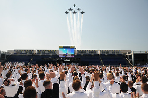 Midshipmen cheer as the Navy Blue Angels fly overhead during the U.S. Naval Academy Class of 2012 graduation and commissioning ceremony. by Official U.S. Navy Imagery