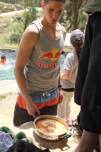 Boy with pan of shakshuka