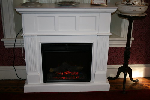 Electric fireplace across from the bed