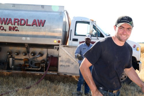 James and fuel man, Jessie get ready to fill up the service truck