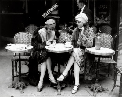 women-sitting-at-a-cafe-terrace