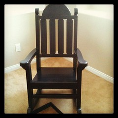 My new rocking chair, custom built by my father-in-law. He even painted it black and avoided southwest carvings (his typical style)