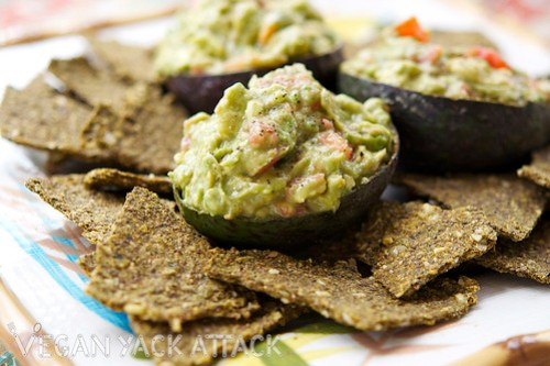 This Raw Flax Crackers recipe is great for utilizing your leftover juice pulp to make a tasty, raw snack. Paired with a simple, yet delicious guacamole dip it is sure to please.