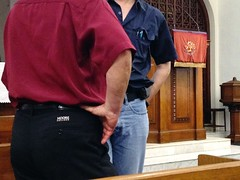 "Close-up of Barry Webb's branded ""Moore College"" trousers at Orchard Road Presbyterian Church, Orchard Road"