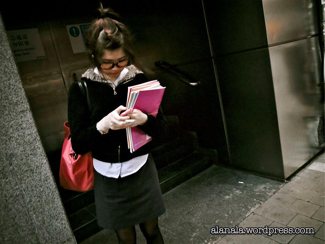 Young lady texting after work