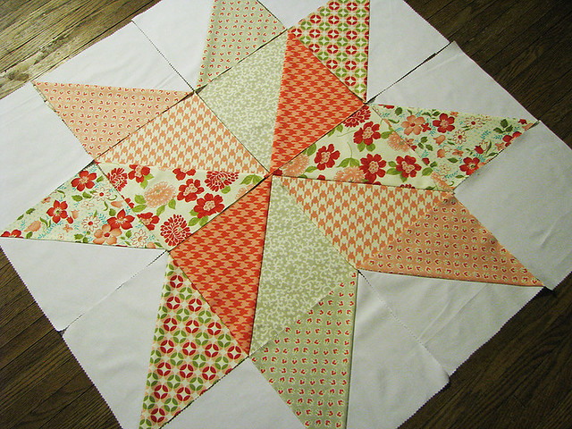 star quilt blocks laid out on the floor