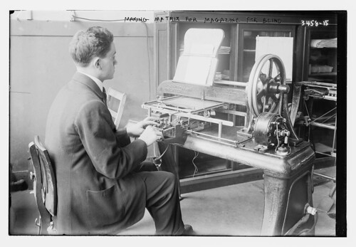 """Making Matrix for magazine for blind."" Photograph from glass negative, between ca. 1900 and ca. 1915. Image depicts a man at the New York Institute for the Blind using a Stereograph, a machine for embossing zinc plates with Braille, to use as publishing masters."