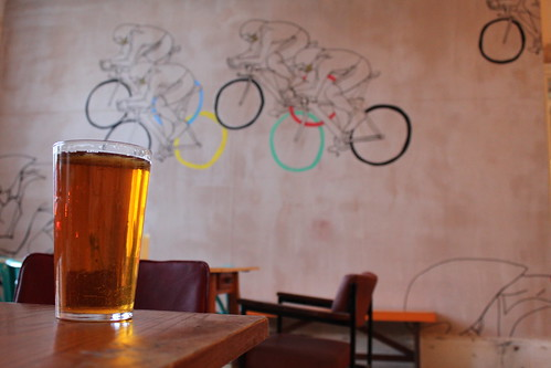 Pint and mural of bicycles