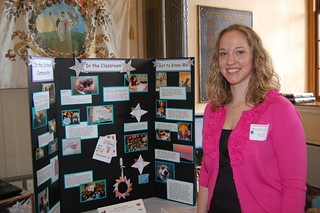 A Teacher of the Year nominee poses with her display boards.