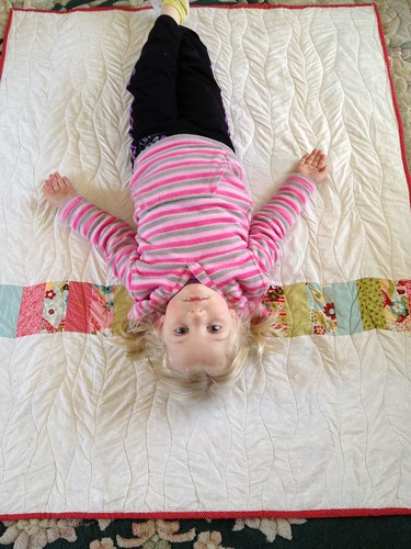 alice upside down on quilt