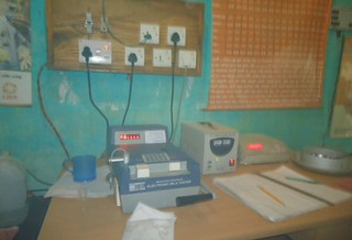 Milk weight recording machine in Buruj market, Bangladesh