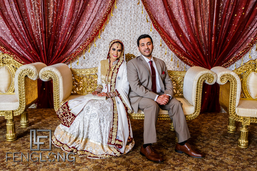 Bride and groom on stage posing for portraits