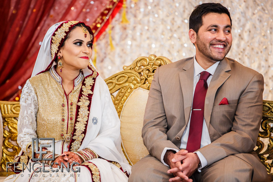 Bride and groom on couch during speeches at Indian wedding reception